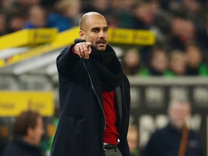 Bayern Munich's Spanish head coach Pep Guardiola gestures during the German first division Bundesliga football match Borussia Monchengladbach vs FC Bayern Munich in the German city of Moenchengladbach on January 24, 2014