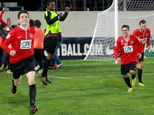 Ile Rousse's players celebrate after winning the French cup football match Ile Rousse (FBIR) vs Bordeaux (FCGB) on January 22, 2014