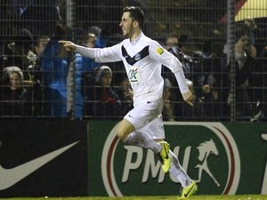 Moulins' French midfielder Jason Berthomier celebrates after scoring a goal during a French Cup football match between AS Moulins and Toulouse (TFC) on January 22, 2014