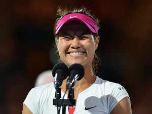 China's Li Na delivers a speech after her victory against Slovakia's Dominika Cibulkova during the women's singles final on day 13 of the 2014 Australian Open tennis tournament in Melbourne on January 25, 2014