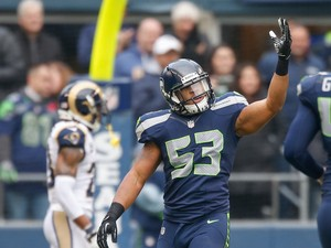 Linebacker Malcolm Smith #53 of the Seattle Seahawks celebrates after scoring a touchdown on a pickoff against the St. Louis Rams at CenturyLink Field on December 29, 2013