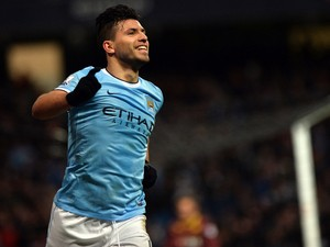 Manchester City's Argentinian striker Sergio Aguero celebrates scoring his third goal during the English FA Cup fourth round football match between Manchester City and Watford at the Etihad Stadium in Manchester on January 25, 2014