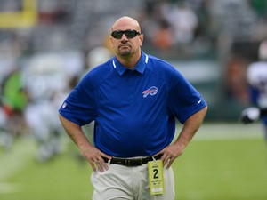 Defensive coordinator Mike Pettine of the Buffalo Bills on the field before the start of their game at MetLife Stadium on September 22, 2013
