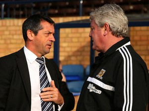 Opposing managers Phil Brown of Southend and Steve Bruce of Hull greet each other prior to kickoff during the FA Cup fourth round match on January 25, 2014
