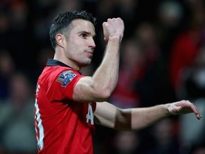 Robin van Persie leaves the pitch after Manchester United defeat Arsenal 1-0 on November 10, 2013.