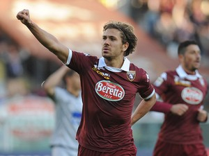 Alessio Cerci of Torino FC celebrates after scoring the opening goal from the penalty spot during the Serie A match between Torino FC and Atalanta BC at Stadio Olimpico di Torino on January 26, 2014