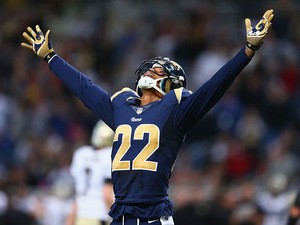 Trumaine Johnson #22 of the St. Louis Rams celebrates after opponents New Orleans Saints missed a field goal in the final minutes on December 15, 2013