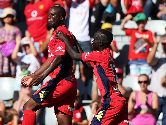 Bruce Djite of Adelaide United celebrates after scoring a goal with his team mate Awer Mabil of Adelaide United during the round 16 A-League match between Adelaide United and the Melbourne Heart at Coopers Stadium on January 25, 2014