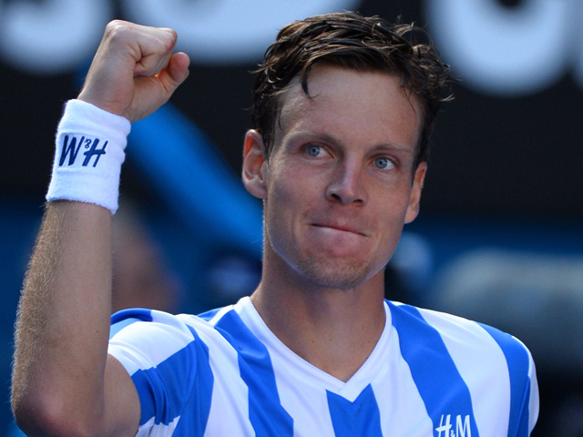 Czech Republic's Tomas Berdych celebrates after victory in his men's singles match against Spain's David Ferrer on day nine at the 2014 Australian Open tennis tournament in Melbourne on January 21, 2014