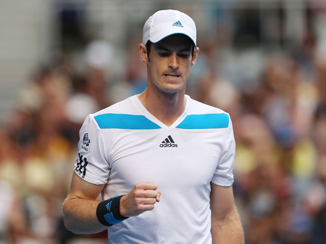 Andy Murray of Great Britain celebrates a point in his fourth round match against Stephane Robert of France during day eight of the 2014 Australian Open at Melbourne Park on January 20, 2014