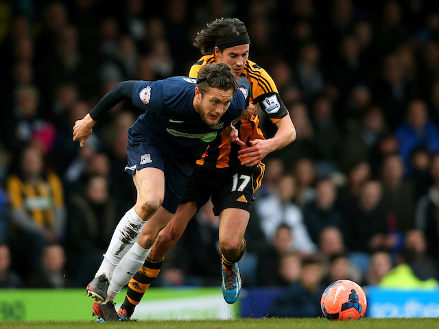 Ben Coker of Southend is challenged by George Boyd of Hull City during the FA Cup fourth round match between Southend United and Hull City at Roots Hall on January 25, 2014