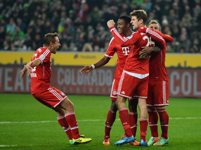 Bayern Munich's midfielder Thomas Muller and his teammates celebrate during the German first division Bundesliga football match Borussia Monchengladbach vs FC Bayern Munich in the German city of Moenchengladbach on January 24, 2014