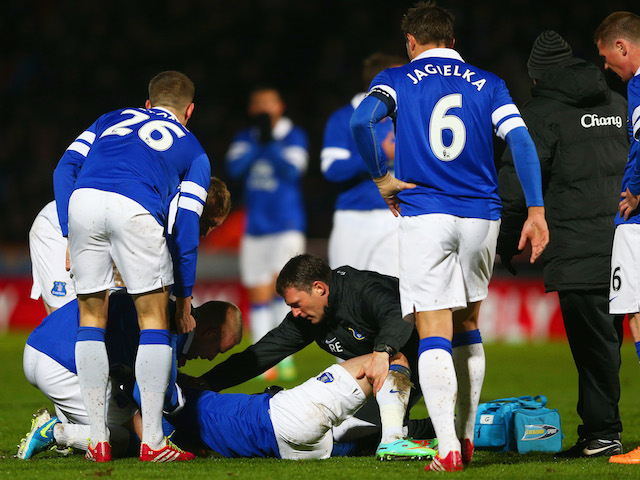 Bryan Oviedo of Everton lies on the ground as he receives treatment during the Budweiser FA Cup fourth round match against Stevenage on January 25, 2014