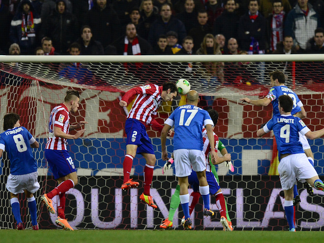 Atletico Madrid's Uruguayan defender Diego Godin scores during the Spanish league football match Atletico Madrid vs Athletic Club Bilbao at the Vicente Calderon stadium in Madrid on January 23, 2014