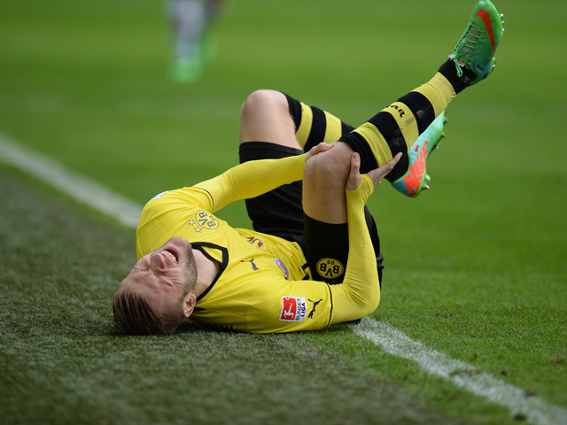 Dortmund's Polish midfielder Jakub Blaszczykowski lies on the pitch during the German first division Bundesliga football match Borussia Dortmund vs FC Augsburg in the German city of Dortmund on January 25, 2014