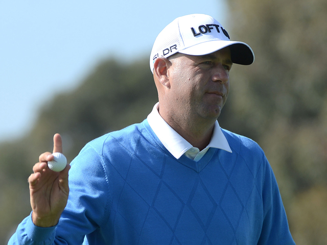 Stewart Cink sinks a birdie putt on the 4th green on the North Course during the first round of the Farmers Insurance Open at Torrey Pines South on January 23, 2014