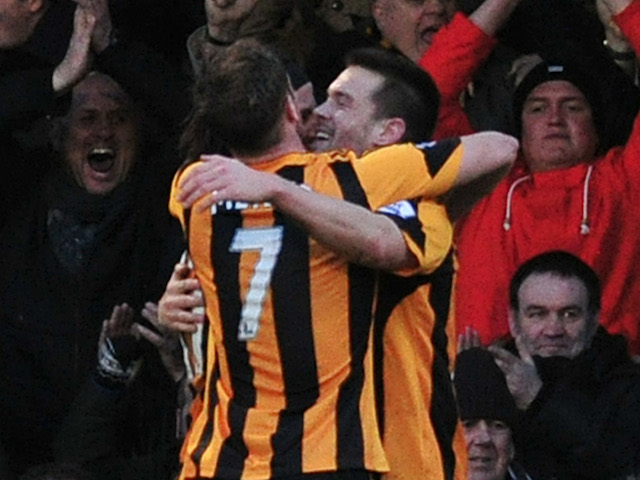 Hull City players celebrate after forward Matty Fryatt scored during the English FA Cup fourth round football match against Southend United on January 25, 2014