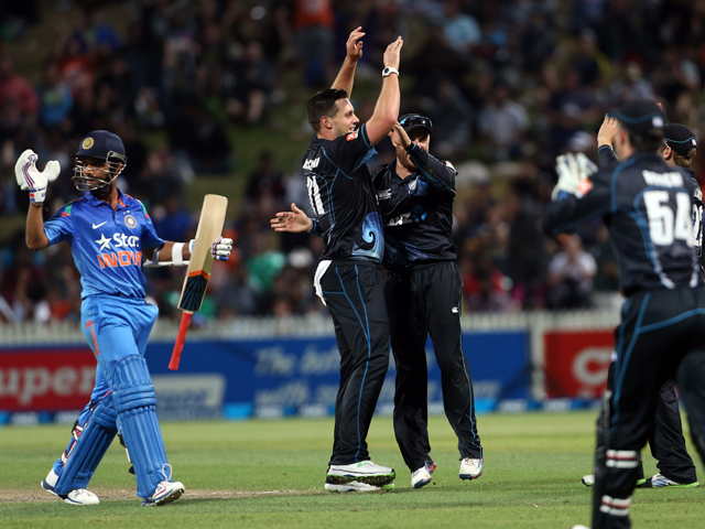 Mitchell McClenaghan from New Zealand celebrates the wicket of India's Ajinkya Rahane during the one day international cricket match between New Zealand and India at Seddon Park in Hamilton on January 22, 2014