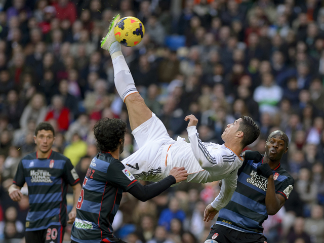 Real Madrid's Portuguese forward Cristiano Ronaldo kicks the ball during the Spanish league football match Real Madrid vs FC Granada at the Santiago Bernabeu stadium in Madrid on January 25, 2014