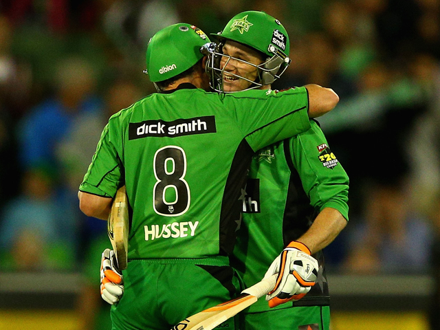 David Hussey and Peter Handscomb of the Stars celebrate a win during the Big Bash League match between the Melbourne Stars and the Hobart Hurricanes at Melbourne Cricket Ground on January 21, 2014