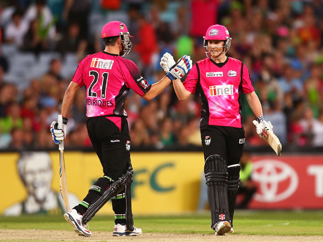 Moises Henriques and Nic Maddinson of the Sixers celebrate winning the Big Bash League match between Sydney Thunder and the Sydney Sixers at ANZ Stadium on January 25, 2014