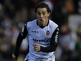 Andres Guardado of Valencia runs with the ball during the Copa del Rey round of 16 first leg match between Valencia CF and Atletico de Madrid at Estadio Mestalla on January 07, 2014