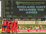 England celebrate after winning the match and retaining the Ashes during game one of the International Twenty20 series between Australia and England at Blundstone Arena on January 29, 2014