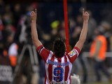 Atletico Madrid's forward David Villa celebrates after scoring the opener during the Spanish league football match Club Atletico de Madrid vs Real Sociedad at the Vicente Calderon stadium in Madrid on February 2, 2014