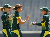 Jess Jonassen of Australia celebrates the wicket of Natalie Sciver of England during game two of the International Twenty20 series between Australia and England at Melbourne Cricket Ground on January 31, 2014