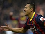 Barcelona's Chilean forward Alexis Sanchez celebrates after scoring a goal during the Spanish league football match FC Barcelona vs Valencia CF at the Camp Nou stadium in Barcelona on February 1, 2014