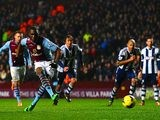 Aston Villa's Christian Benteke scores his team's fourth goal via the penalty spot against West Brom during their Premier League match on January 29, 2014