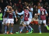 Aston Villa's Fabian Delph is congratulated by teammates after scoring his team's third goal against West Brom during their Premier League match on January 29, 2014