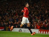 Robin van Persie of Manchester United celebrates scoring the opening goal during the Barclays Premier League match between Manchester United and Ca