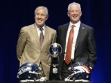 Head coach Pete Carroll of the Seattle Seahawks and opposite number John Fox of the Denver Broncos attend a Super Bowl XLVIII head coach joint press conference at the Rose Theater on Friday night