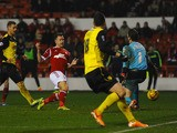 Simon Cox of Nottingham Forest scores during the Sky Bet Championship match between Nottingham Forest and Watford at City Ground on January 30, 2014