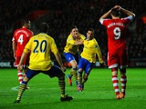 Santi Cazorla of Arsenal celebrates scoring their second goal with Olivier Giroud of Arsenal during the Barclays Premier League match between Southampton and Arsenal at St Mary's Stadium on January 28, 2014