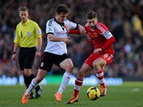 William Kvist (L) of Fulham in action against Adam Lallana of Southampton during the Barclays Premier League on February 1, 2014