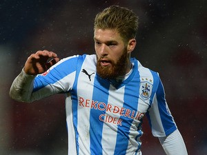 Adam Clayton of Huddersfield Town in action during the Budweiser FA Cup Fourth Round match against Charlton Athletic on February 1, 2014