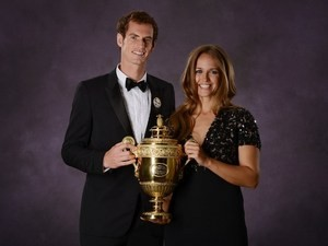 Andy Murray poses with the 2013 Wimbledon trophy along with his girlfriend Kim Sears during the Wimbledon Champions Dinner in Central London on July 7, 2013