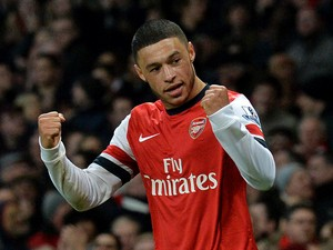 Arsenal's English midfielder Alex Oxlade-Chamberlain celebrates after scoring his second goal during the English Premier League football match between Arsenal and Crystal Palace at the Emirates Stadium in London on February 2, 2014