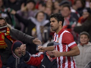 Atletico Madrid's Brazilian forward Diego da Silva Costa celebrates after scoring during the Spanish league football match Club Atletico de Madrid vs Real Sociedad at the Vicente Calderon stadium in Madrid on February 2, 2014