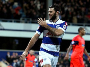 QPR's Charlie Austin celebrates after scoring the opening goal against Bolton during their Championship match on January 28, 2014