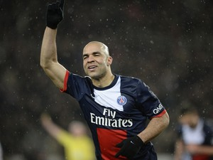 Paris' Brazilian defender Alex Costa celebrates after scoring during a French L1 football match between Paris Saint-Germain (PSG) and Bordeaux (FCGB) on January 31, 2014