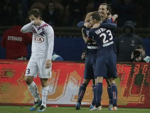 Swedish forward Zlatan Ibrahimovic celebrates with teammates after scoring during a French L1 football match between Paris Saint-Germain (PSG) and Bordeaux (FCGB) on January 31, 2014