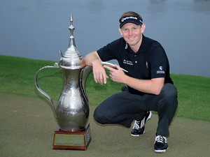 Stephen Gallacher of Scotland with the trophy after the final round where he became the first back to back winner of the Omega Dubai Desert Classic on the Majlis Course at the Emirates Golf Club on February 2, 2014