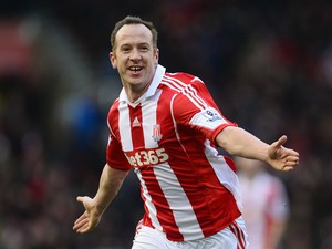Charlie Adam of Stoke City celebrates scoring the opening goal during the Barclays Premier League match between Stoke City and Manchester United at Britannia Stadium on February 1, 2014