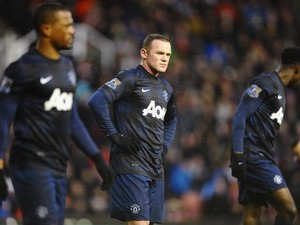 Wayne Rooney of Manchester United looks dejected during the Barclays Premier League match between Stoke City and Manchester United at Britannia Stadium on February 1, 2014