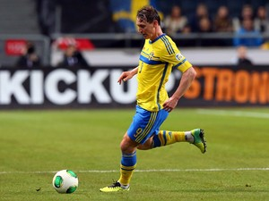 Kim Kallstrom of Sweden runs with the ball during the FIFA 2014 World Cup Qualifier Play-off Second Leg match between Sweden and Portugal at Friends Arena on November 19, 2013