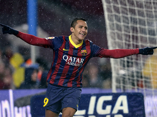 Barcelona's Alexis Sanchez celebrates after scoring his team's third goal against Levante during their Copa del Rey quarter-final match on January 29, 2014