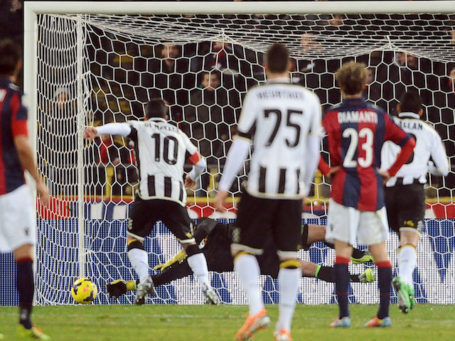 Antonio Di Natale of Udinese Calcio scores a goal from the penalty spot during the Serie A match against Bologna FC